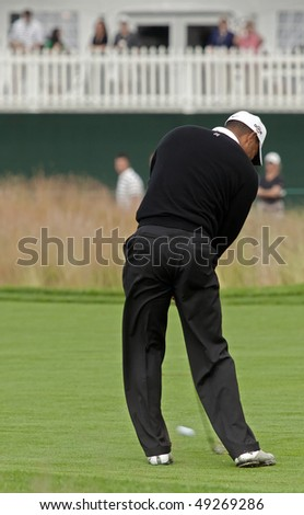 FARMINGDALE, NY - JUNE 16: Tiger Woods hits his approach shot to the 18th hole on the Black Course during the 2009 US Open on June 16, 2009 in Farmingdale, NY. - stock photo