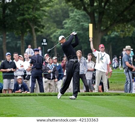 FARMINGDALE, , NY - JUNE 16: Tiger Woods tees off the 12th hole on the Black Course during a practice round at the 2009 US Open on June 16, 2009 in Farmingdale, NY. - stock photo