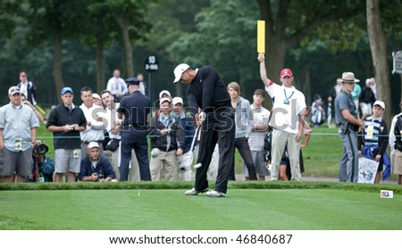FARMINGDALE, NY - JUNE 16: Tiger Woods tees off the 12th hole on the Black Course during the 2009 US Open on June 16, 2009 in Farmingdale, NY. - stock photo