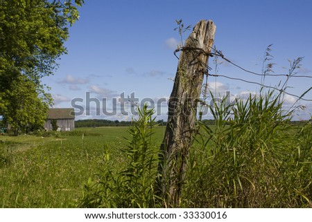 Farmland and fence post - stock photo