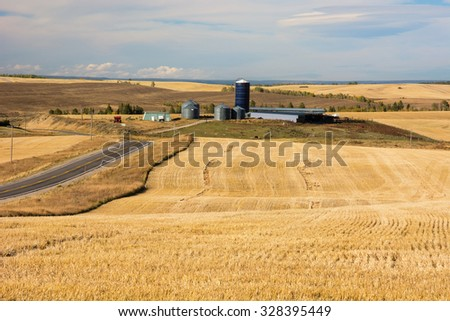 Farmland and rolling hills in the state of Idaho. - stock photo