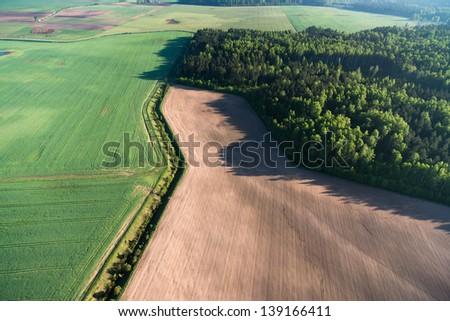 Farmland at spring, aerial view - stock photo