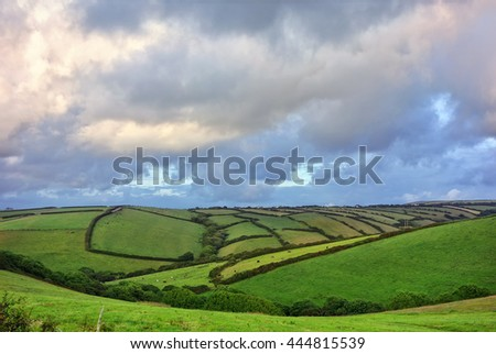 Farmland at sunset. English fields and hedgerows. Landscape. - stock photo