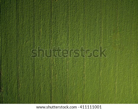 Farmland from above - aerial image of a lush green filed - stock photo