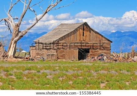 Farmland in America with Old Barn - stock photo