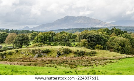 Farmland in the foot hills of Snowdonia - stock photo
