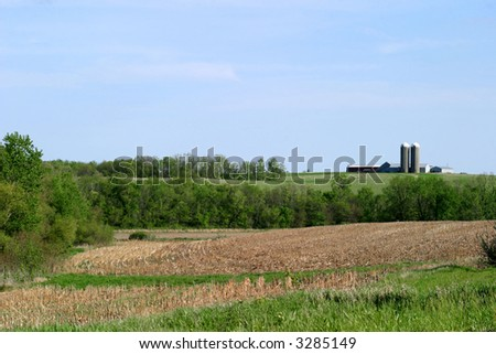 Farmland - SE rural Iowa landscape with a farm in the background. - stock photo