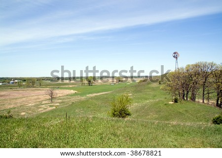 Farms and a wind-pump tower - stock photo