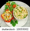 Farmstyle cottage pie with a stuffed pepper and salad. - stock photo