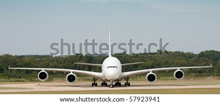 FARNBOROUGH INTERNATIONAL AIRSHOW, UK - JULY 20: Panorama of the Airbus A380 jet airliner taxiing. Farnborough Airshow, July 20, 2010. Hampshire, UK. - stock photo
