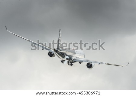 FARNBOROUGH, UK - JULY 14: Airbus 350 XWB take-off from international aviation trade event at Farnborough, Hampshire, UK on July 14, 2016 - stock photo