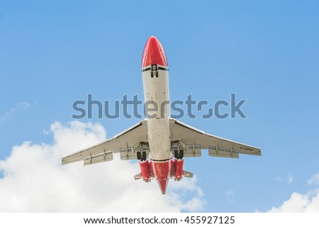 FARNBOROUGH, UK - JULY 14: Boeing 727 oil spill response aircraft operated by OSRL, landing at an aviation trade event in Farnborough, UK on July 14, 2016 - stock photo