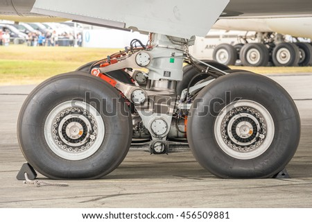 FARNBOROUGH, UK - JULY 15: Close-up section of an Airbus A350 undercarriage on the taxiway at an aviation trade event in Farnborough, UK on July 15, 2016 - stock photo