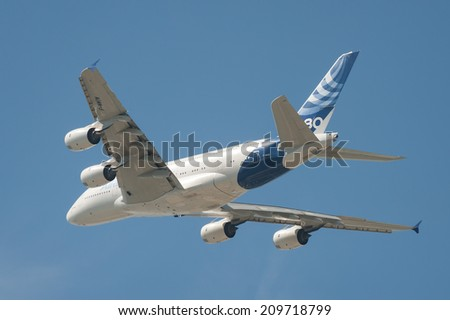 FARNBOROUGH, UK - JULY 18: Closeup of the flagship Airbus A380 super-jumbo jet airliner in flight over Farnborough, Hampshire, UK on July 18, 2014 - stock photo