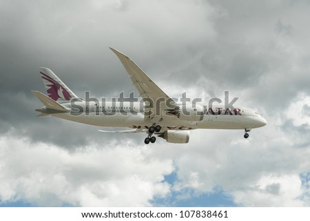 FARNBOROUGH, UK - JULY 11: The newly unveiled Boeing 787 Dreamliner in Qatar Airways livery on landing approach to the international airshow at Farnborough, UK on July 11, 2012 - stock photo
