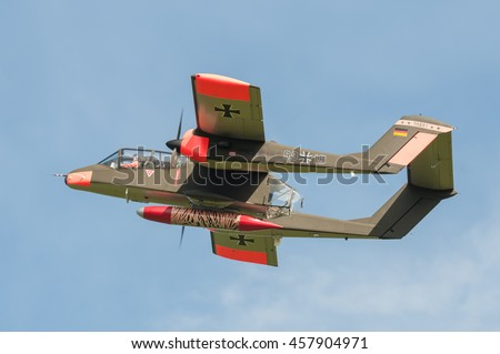 FARNBOROUGH, UK - JULY 18: Vintage Rockwell OV-10 Bronco light attack aircraft on take-off from Farnborough, UK on July 18, 2016 - stock photo