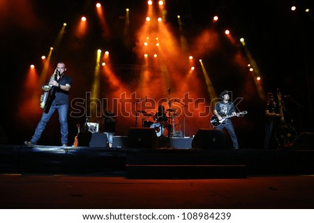 FARO, PORTUGAL - JULY 21: Rebeldes performs onstage at the International Motorcycle Meeting JULY 21, 2012 in Faro, Portugal. - stock photo