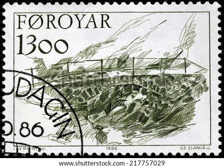 FAROE ISLANDS - CIRCA 1986: A stamp printed by FAROE ISLANDS shows ancient stone bridge.  Engraving after drawing by most celebrated painter of the Faroe Islands Ingalvur av Reyni, circa 1986.