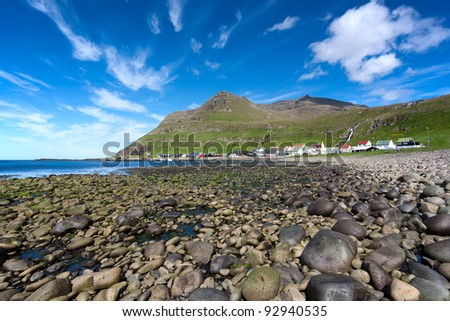 Faroe Islands. Shingle beach of Famjin, a village on the sea surrounded by unspoilt nature .
