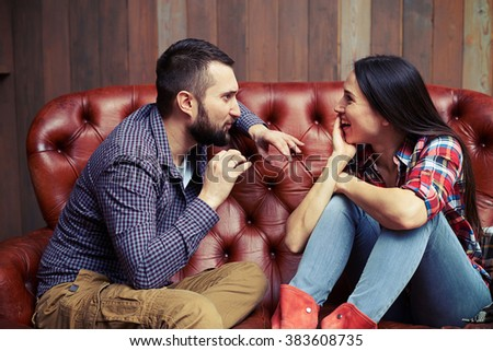 fascinating conversation between a man and a woman - stock photo