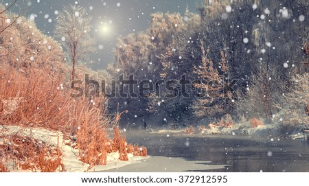 Fascinating winter landscape. Frosty, misty morning on the small river. frost covered trees in the warm glow of sunrise on the beach. The beauty of the world.. Creative collage. Instagram effect - stock photo