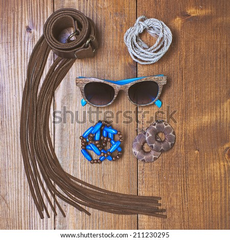 Fashion accessories on wooden vintage background - stock photo