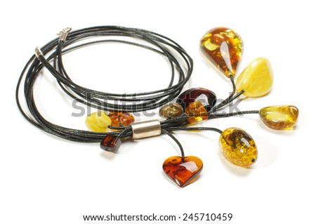 Fashion amber necklace isolated on the white background - stock photo