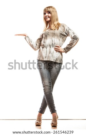 Fashion and advertisement concept. Full length woman casual style holding open palm empty hand showing copy space for product isolated - stock photo