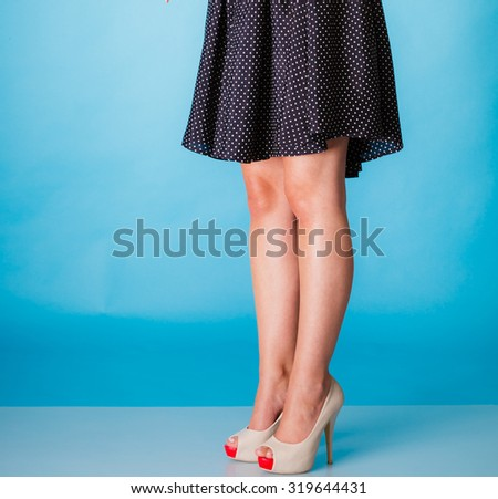 Fashion and beauty of female part body. Sexy girl legs in high heels. Studio shot. - stock photo