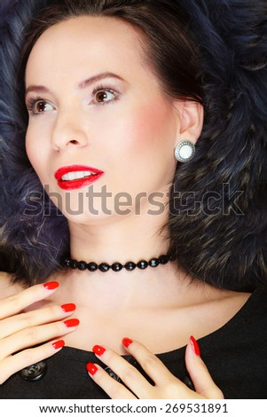 Fashion and beauty.  Woman in fur coat red lips and nails, lady retro style portrait