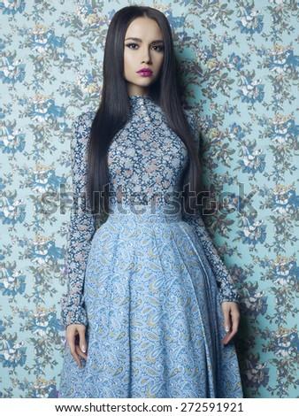 Fashion art photo of beautiful elegant lady on floral background. Spring/Summer - stock photo