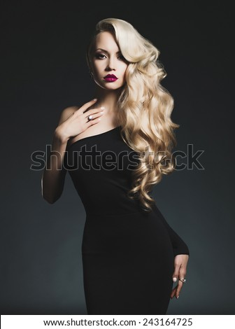 Fashion-art photo of elegant blonde on black background - stock photo