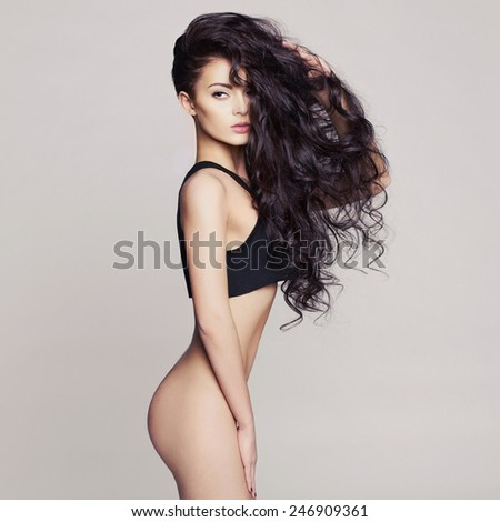 Fashion art photo of sexy naked lady with long healthy hair - stock photo