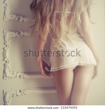 Fashion art photo of young sensual lady in classical interior - stock photo