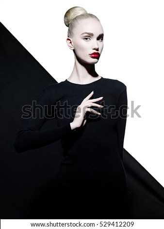 Fashion art studio portrait of elegant woman with red lips.