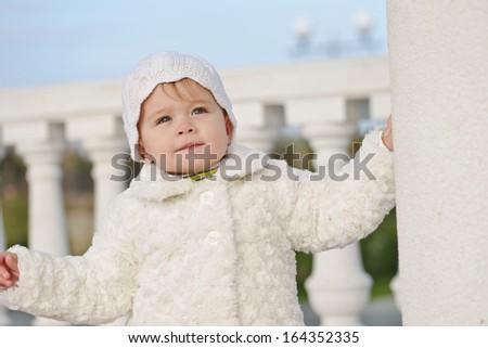 fashion baby girl wearing fur coat - stock photo