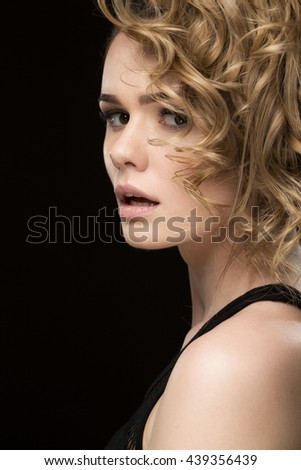 Fashion baby. Vertical shot of a stunning sexy young woman with short curly hairstyle looking to the camera surprised with her mouth open - stock photo