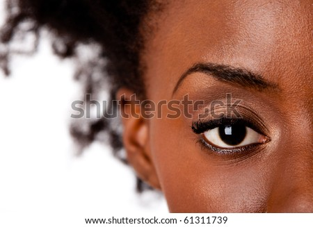 Fashion beautiful African American female brown watchful eye with black eyelashes mascara, isolated. - stock photo