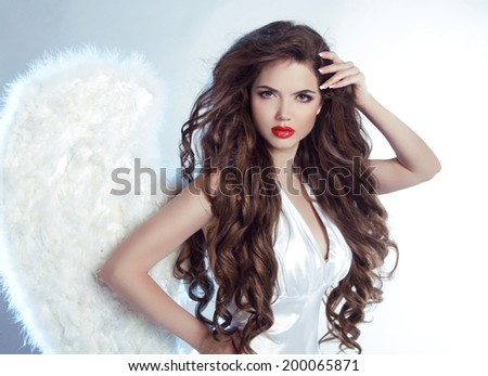 Fashion Beautiful Angel Girl model with wavy long hair - stock photo