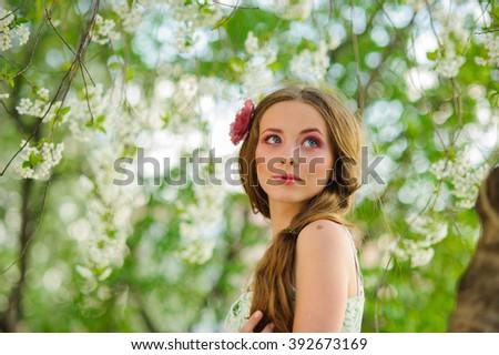 fashion beautiful blonde  woman in a spring garden - stock photo
