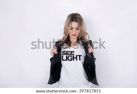Fashion beautiful girl in black jacket in photo studio with white background. NYC, NY, USA. Febr, 14, 2016