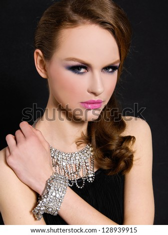 fashion beautiful glamour girl with bright make-up-and bracelet , Jewelry - stock photo