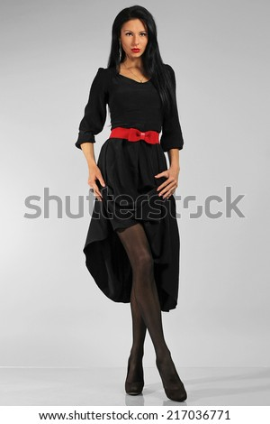 Fashion beautiful woman in a full-length - stock photo