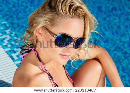 Fashion beautiful woman in sunglasses in luxury pool. Vogue style - stock photo
