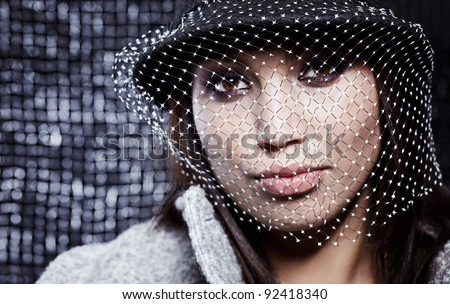 Fashion Beautiful Woman over grey background