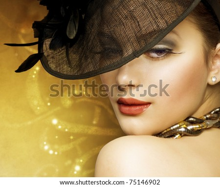 Fashion Beautiful Woman over luxury gold background - stock photo