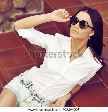 Fashion beautiful woman portrait wearing sunglasses - stock photo