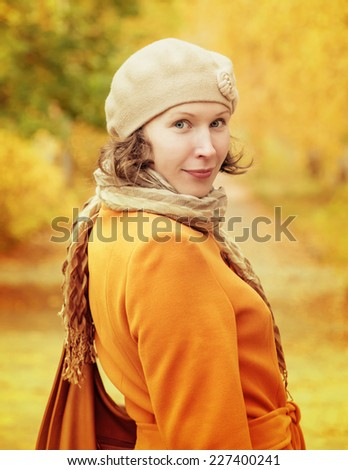 Fashion beautiful woman walking in autumn park.