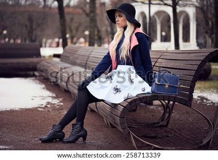Fashion beautiful woman with bag outdoors - stock photo
