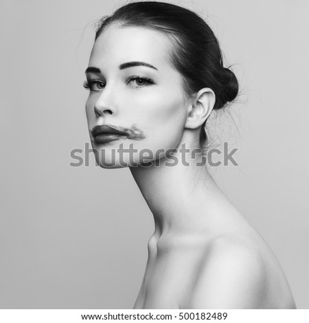 Fashion beautiful woman with smeared lipstick in profile